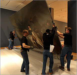 The crew hoisted up the painting.