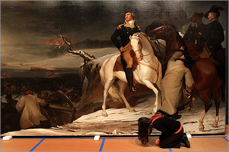 Sandy Kelberlau, the Cunningham assistant conservator of painting, looked over the bottom of the painting during the installation.