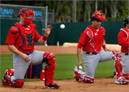 Boston Red Sox catchers Jason Varitek and Victor Martinez participate in drills on the first official day of workouts for pitchers and catchers.