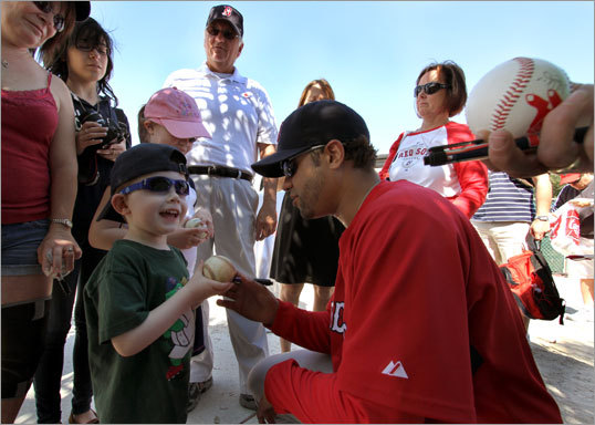 A happy Conor Taft of Rockland got an autograph from Red Sox relief pitcher Manny Delcarmen.