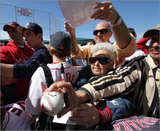 Norma Murphy, 80, now of Hernano, Fla. and originally from Acton, looked for an autograph from newly acquired Red Sox pitcher John Lackey.