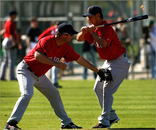 Red Sox pitcher Tim Wakefield playfully applied the tag on pitcher Daisuke Matsuzaka during a break in workouts.