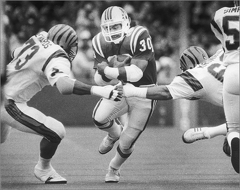 Tatupu was on the Patriots from 1978 to 1990 and played on the 1985 team that lost to the Bears in Super Bowl XX. Tatupu was selected for the Pro Bowl in 1986. During home games in Foxborough, a group of Tatupu fans behind the end zone held a banner entitled 'Mosi's Mooses.' 'They are great fans, but just to have your own section is an honor,' Tatupu said in a 2004 interview with the Globe. 'It inspired me to play harder because they were cheering for me and backing me up.' <br.Tatupu ran for a long gain in this 1984 game against vs. the Bengals.