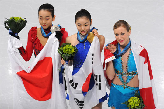 South Korea's Kim Yu Na (center) won gold in the women's figure skating competition. Mao Asada of Japan (lefft) won silver and Canada's Joannie Rochette took bronze.