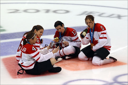 Team Canada players got the party started right on the ice after winning the gold-medal game of the women's hockey tournament. Canada defeated the US, 2-0.