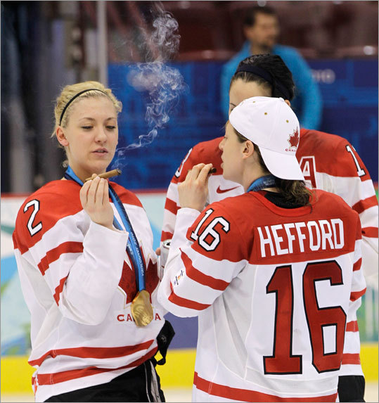 Canada's Meghan Agosta (left) and Jayna Hefford lit up victory cigars.