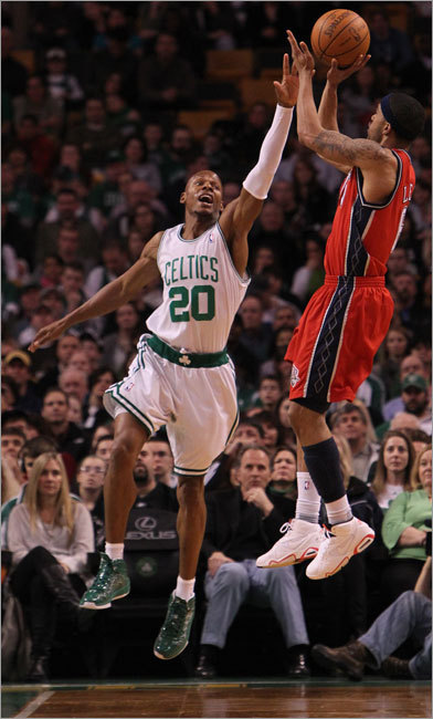 Courtney Lee shot a jump shot over Celtics guard Ray Allen during second quarter action at TD Garden Saturday.