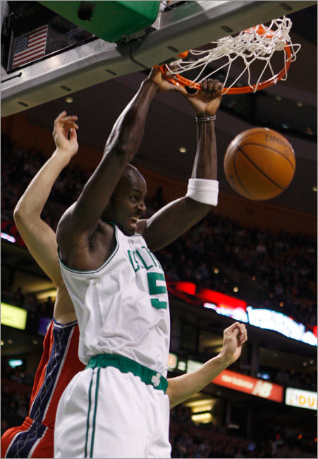 Kevin Garnett slam dunked over the New Jersey Nets' Yi Jianlian during first quarter play Saturday..