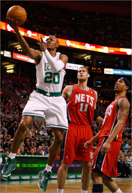 Ray Allen drove to the basket, beating the New Jersey Nets' Brook Lopez and Courtney Lee during the first quarter.