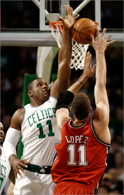 Boston Celtics forward Glen Davis blocked a shot by New Jersey Nets center Brook Lopez during the second quarter Saturday.