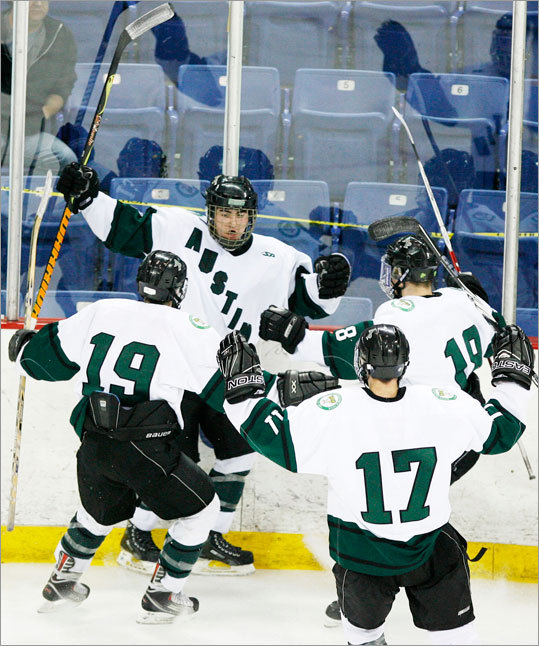 Austin Prep players Casey Miller(19) Brandon Hartt, second from left, Brendan Silk (17) and Shane Hurley (18) celebrated Brandon Hartt's goal against Xaverian.