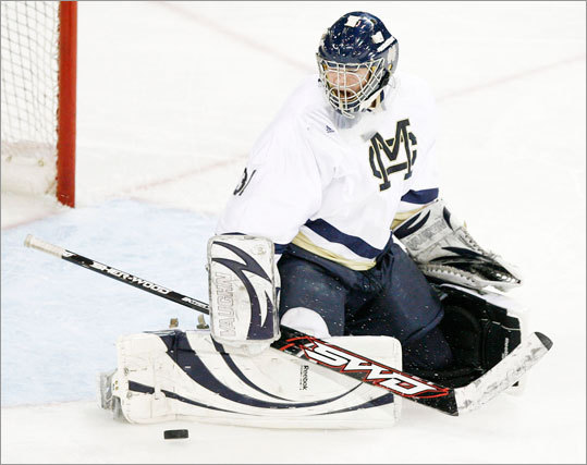 Malden Catholic's Pat Young made a kick save against Needham.