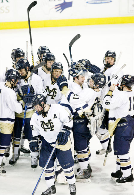 Malden Catholic celebrates its win over Needham.