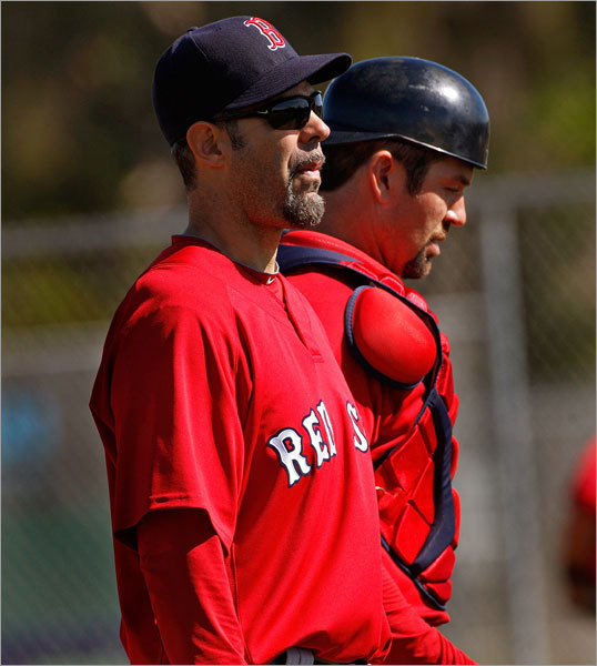 Another first this spring: Mike Lowell (front) took batting practice Monday.