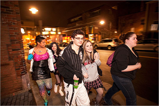 Brian Didio and Nicole Festa (center) walk with friends from Ashland High School to the AMC Theatre.