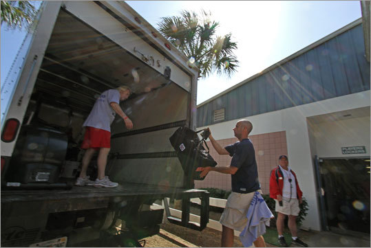 Workers loaded gear onto a truck to help the major league players move from the team's player development complex to City of Palms Park, where spring training games begin on Wednesday.