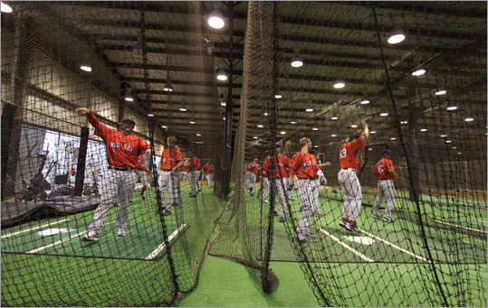 The indoor batting cages were popular during a rainstorm on Tuesday.