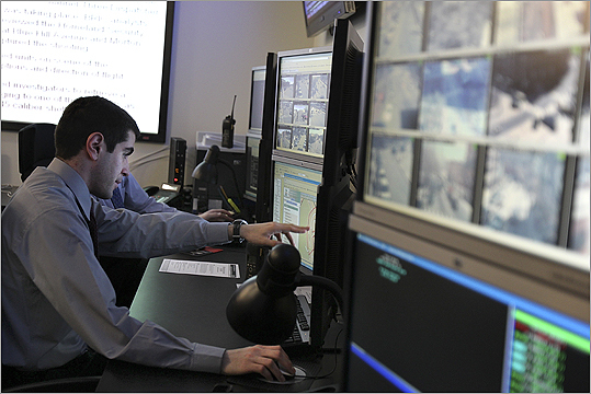 Civilian crime analyst Seth Housman monitors the city's crime response from the new Real Time Crime Center.