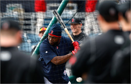 Northeastern players watched as Red Sox DH David Ortiz took batting practice on Wednesday. Northeastern faced the Red Sox in the first spring game for the Sox, who were scheduled to play Boston College later Wednesday.