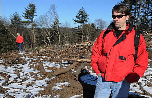 Proposed rule changes exclude the Quabbin, other state-owned watershed land, and Division of Fish and Game property, where clear-cutting is still allowed in order to create habitat for certain species. Ian Bowles, state secretary of energy and environmental affairs, said he is examining forestry practices more closely at the Quabbin and on Division of Fish and Game lands and is likely to ban commercial logging on them. From left: Hurley and Matera inspect the destruction off Woodward Road in Petersham.