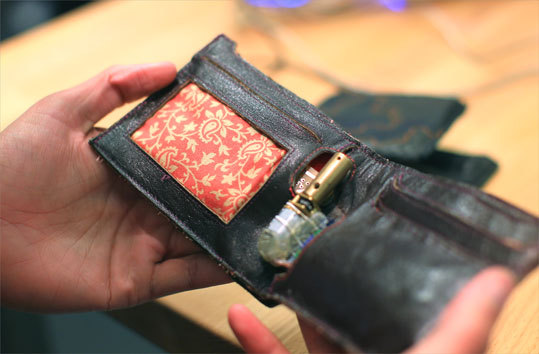 Researchers at the Media Lab created a new way to curb big spenders: this Proverbial Wallet becomes harder to open as the balance of its owner's bank account shrinks. Another Proverbial Wallet at the lab swells and shrivels with the amount of available cash; a third buzzes when there is a transaction in any account linked to it.