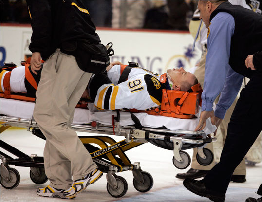 Team trainers and medical staff carried Marc Savard off the ice on a stretcher. Savard suffered a concussion, the Bruins announced after the game.
