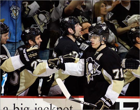 Earlier in the game, Pittsburgh's Evgeni Malkin celebrated his goal that put the Penguins ahead by the eventual final score of 2-1.