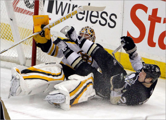 Pittsburgh's Ruslan Fedotenko crashed into Bruins goalie Tim Thomas in the first period. Thomas mad 31 saves for the Bruins in the loss.