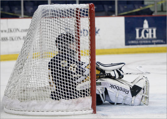 Xaverian goaltender Kyle Macdonald sat in his goal after giving up the second of two late third period goals to Springfield Cathedral during a 2-2 tie in Super 8 pool play.