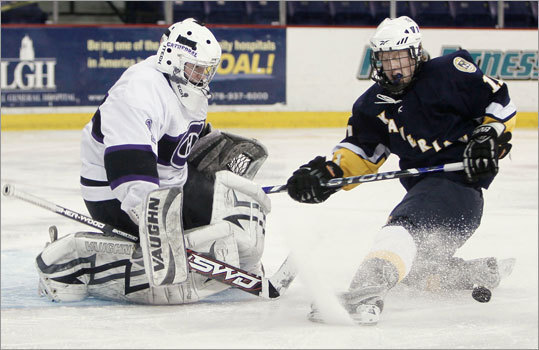 Springfield Cathedral goaltender PJ D'Amario made a save as the rebound bounced past Xaverian's Ryan Hall during their two teams' 2-2 tie in Super 8 pool play.