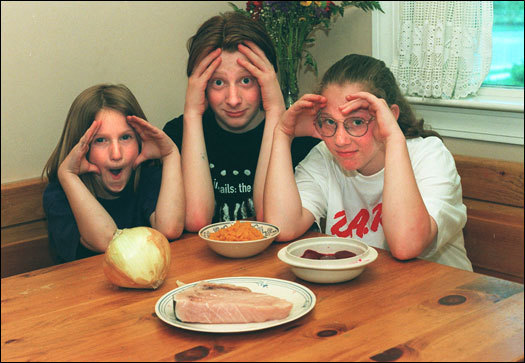 From left: Brenna, Tim, and Maura Curren made faces at food they hate, including swordfish, onion, squash, and beets.