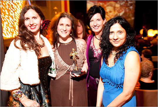 New Brattle members, from left, Eileen Marmora, Robin Shepard, Bernadette Ridge, and Magina Malguria posed with 'Oscar' at the party.