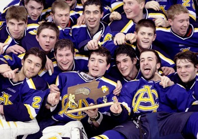 Arlington Catholic players celebrate with the trophy after defeating St. Mary's in the D1 North Final boys hockey game at Chelmsford Arena.