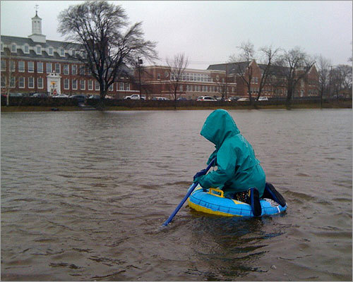 A Milton resident drifted along the water in Cunningham Park on Monday.