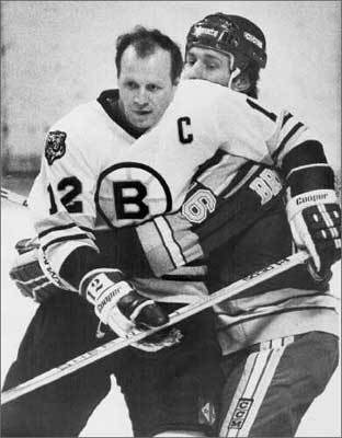 Wayne Cashman In their early '70s heyday, the Bruins didn't have too many true enforcers, just a high number of tough, chippy players who could take care of themselves. Among them were Derek Sanderson, Don Awrey, Johnny 'Pie' McKenzie, and the man pictured here, Wayne Cashman. Cashman spent his entire 17-year career with the Bruins, compiling more than 100 penalty minutes in each season from 1971-72 through 1973-74.