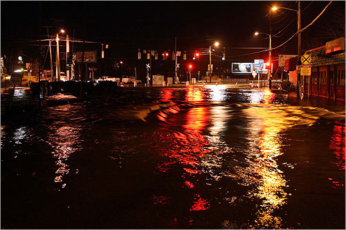 Washington Street at Plain Street are flooded in Braintree.