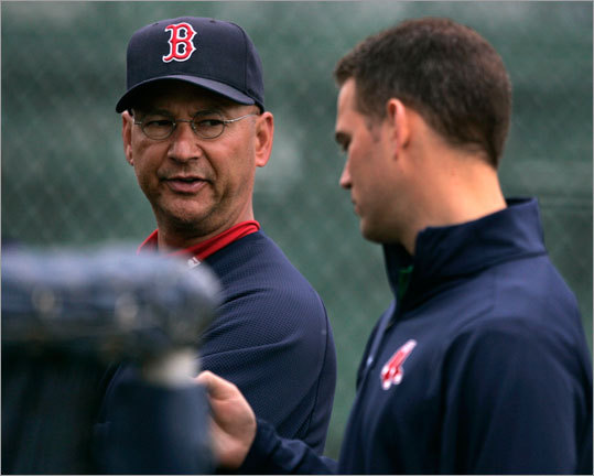 Field manager Terry Francona and general manager Theo Epstein chatted while watching Daisuke Matsuzaka pitch batting practice.