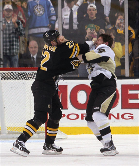 Shawn Thornton (left) and Matt Cooke both got five-minute penalties for fighting, and Thornton also was given a 10-minute game misconduct penalty.