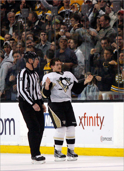 Matt Cooke heard it from the crowd as he was escorted to the penalty box after fighting with Shawn Thornton.