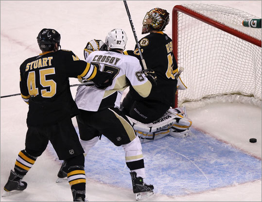 The Penguins made it 2-0 with only 14 seconds left in the second period when Alexei Ponikarovsky (not pictured) scored on Tuukka Rask. Bruins defenseman Mark Stuart and Penguins center Sidney Crosby had front-row seats for the goal.