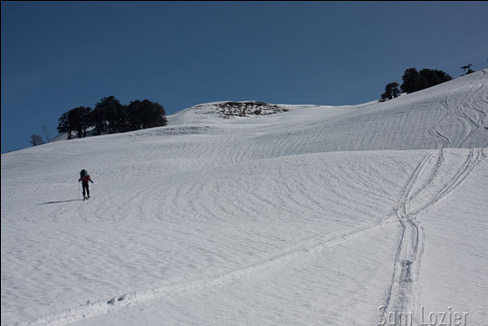 Ski blogger Sam Lozier is spending a chunk of this winter skiing in India. The following photos are from a recent trek in the Gulaba backcountry. Starting out on hard snow near Gulaba. Tracks are from heli-drops in the area.