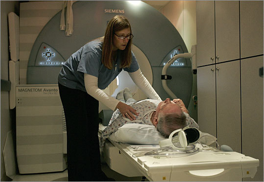 MRI tech Elizabeth Curry helps a patient with his MRI at Carney Hospital in 2007.