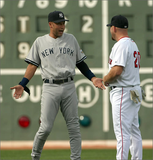 Maybe, judging by this photo of apparent chums Derek Jeter and Kevin Youkilis at Fenway last season, the Red Sox-Yankees rivalry isn't as heated as it used to be. Oh, who are we kidding -- of course it is! Come Sunday night, when the teams open the 2010 season at Fenway Park, both teams -- or both fan bases, at least -- will want to start the others' season off on a losing note. This season could shape up to be a particularly interesting chapter. The Yankees are the defending champs and have added reinforcements in Javier Vazquez and Curtis Granderson, while the Sox have made major improvements in pitching (John Lackey) and defense (Adrian Beltre, Mike Cameron). We'd be foolish to judge which team is better before a pitch in the new season has even been delivered. But we'll gladly take a glance at the positional matchups, than leave it up to you to decide which team is superior at each spot on the field. Oh, and as for what this photo really tells us . . . upon a second glance, could Jeter be defending himself against an accusation from Youkilis? Maybe that, say, his trademark jump-throw from the hole is all for show? Sox fans would like to believe so. Yeah, it's still a rivalry.