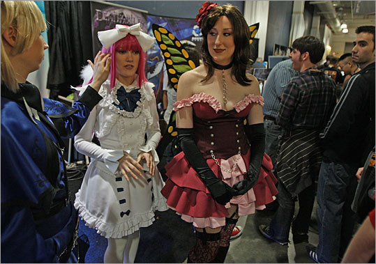 Characters from the 'Deathsmiles' game, Casper (in blue) and Windia (in white), walk around at the three-day Pax East 2010 gaming convention at the Hynes Convention Center on Saturday.