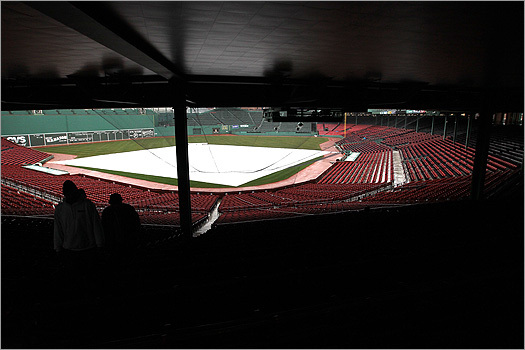 Tarps covered the field as rain poured down during the annual walk-through today at Fenway Park. Mayor Thomas M. Menino toured Fenway to see improvements and repairs made at the ballpark during the off-season.