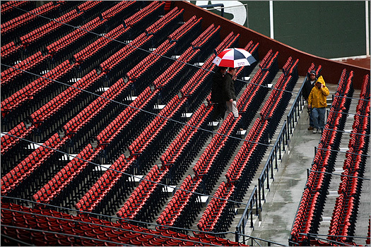 Someone at the park held a Red Sox umbrella in the stands.