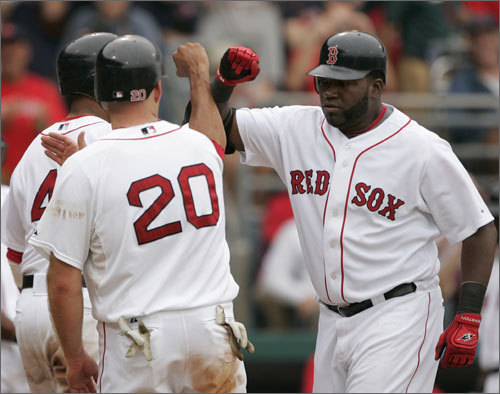 David Ortiz, Kevin Youkilis, and Victor Martinez congratulated each other after Martinez drove all three of them in on a home run off of Twins' pitcher Carl Pavano.