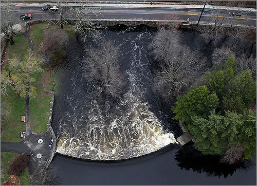 The overflow of the Natick Dam by Route 16.