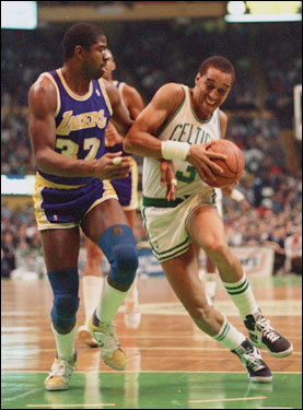 In this Dec. 1986 photo, Johnson (right) drove the lane against the Los Angeles Lakers' Earvin 'Magic' Johnson.