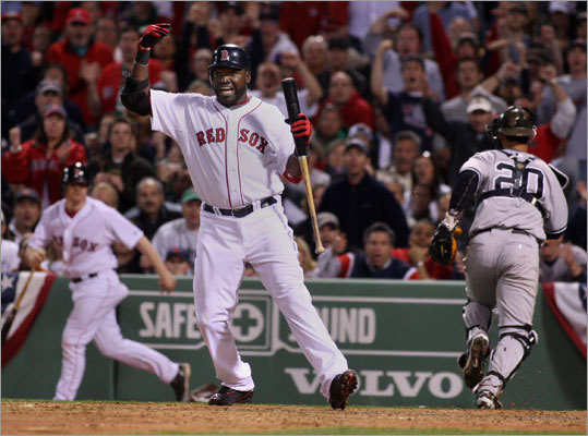 David Ortiz waved for Kevin Youkilis to come to the plate after a pitch got away from Yankees catcher Jorge Posada.
